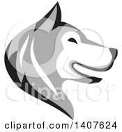 Clipart Of A Retro Alaskan Malamute Husky Dog Head In Profile Royalty Free Vector Illustration