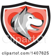 Clipart Of A Retro Alaskan Malamute Husky Dog Head In Profile In A Black White And Red Shield Royalty Free Vector Illustration by patrimonio