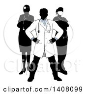 Faceless Silhouetted Male Doctor Wearing A Lab Coat Standing With Hands On His Hips With His Team Behind Him