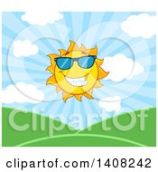 Clipart Of A Yellow Summer Time Sun Character Mascot Over A Hilly Landscape Royalty Free Vector Illustration