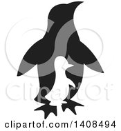 Clipart Of A Silhouetted Chick And Black Adult Penguin Royalty Free Vector Illustration