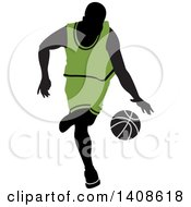 Black Silhouetted Male Basketball Player In A Green Uniform Dribbling The Ball