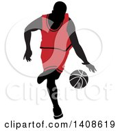 Black Silhouetted Male Basketball Player In A Red Uniform Dribbling The Ball