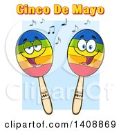 Clipart Of A Pair Of Maraca Characters With Cinco De Mayo Text Over Blue Royalty Free Vector Illustration by Hit Toon
