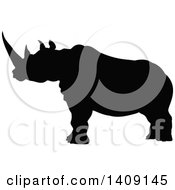 Clipart Of A Black Silhouetted Rhinoceros Royalty Free Vector Illustration