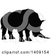 Clipart Of A Black Silhouetted Rhinoceros Royalty Free Vector Illustration by AtStockIllustration