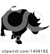 Clipart Of A Black Silhouetted Rhinoceros Charging Royalty Free Vector Illustration by AtStockIllustration