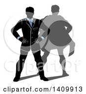 Black White And Blue Silhouetted Business Man Standing With His Hands On His Hips And A Super Hero Shadow
