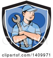 Retro Cartoon White Handy Man Or Mechanic Holding A Spanner Wrench In Folded Arms In A Black White And Blue Shield