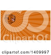 Clipart Of A Retro Woodcut Roaring California Grizzly Bear Head And Orange Rays Background Or Business Card Design Royalty Free Illustration by patrimonio
