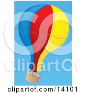 Blue Red And Yellow Hot Air Balloon Floating In A Clear Blue Sky