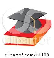 Graduation Cap On Top Of A Text Book School