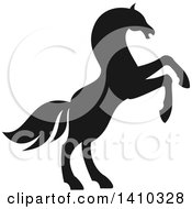 Clipart Of A Black Silhouetted Rearing Horse Royalty Free Vector Illustration