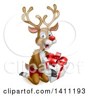 Clipart Of A Happy Rudolph Red Nosed Reindeer Kneeling And Holding A Gift Royalty Free Vector Illustration