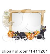 Clipart Of A Halloween Mummy Pointing To A White Board Sign With Pumpkins And Black Cats Royalty Free Vector Illustration by AtStockIllustration