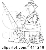 Cartoon Black And White Lineart Fisherman Putting A Worm On A Hook