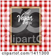 Clipart Of A Vegan Menu Chalkboard Over Red Gingham Cloth Royalty Free Vector Illustration by KJ Pargeter