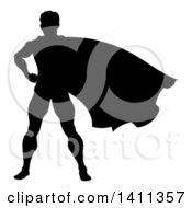 Black Silhouetted Male Super Hero With His Cape Flying