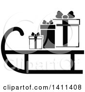 Clipart Of A Black And White Sled And Christmas Gift Icon Royalty Free Vector Illustration