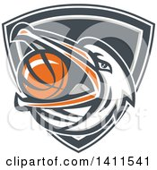Clipart Of A Retro Pelican Bird Holding A Basketball In His Beak In A Shield Royalty Free Vector Illustration