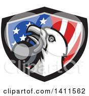 Clipart Of A Retro Bald Eagle Head Holding A Kettlebell In His Beak Over A Patriotic Shield Royalty Free Vector Illustration