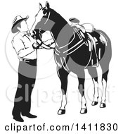 Clipart Of A Black And White Cowboy Petting His Horse Royalty Free Vector Illustration