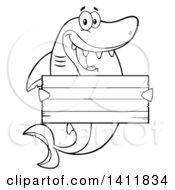 Cartoon Black And White Lineart Happy Shark Mascot Character Holding A Wooden Sign