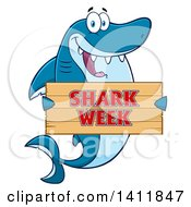 Cartoon Happy Shark Mascot Character Holding A Shark Week Sign