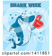 Cartoon Happy Shark Mascot Character Wearing A Foam Finger With Text Over Blue