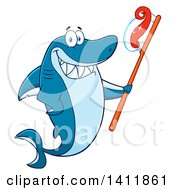 Cartoon Happy Shark Mascot Character Holding A Toothbrush