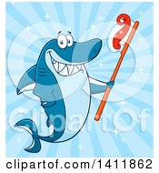 Cartoon Happy Shark Mascot Character Holding A Toothbrush Over Blue