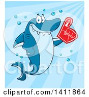 Cartoon Happy Shark Mascot Character Wearing A Foam Finger Over Blue