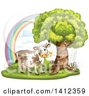 Cow Grazing Under A Tree Against A Rainbow