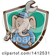 Retro Cartoon Elephant Man Mechanic Holding A Giant Spanner Wrench Emerging From A Brown White And Turquoise Shield