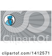 Clipart Of A Retro Blue Dog Sitting With A Horseshoe In His Mouth And Gray Rays Background Or Business Card Design Royalty Free Illustration