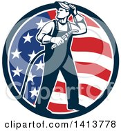 Clipart Of A Retro Full Length Male Welder Looking Back Over His Shoulder In An American Flag Circle Royalty Free Vector Illustration