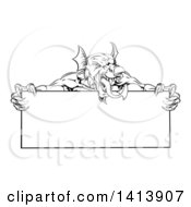 Black And White Muscular Aggressive Welsh Dragon Man Mascot Holding A Blank Sign