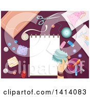 Clipart Of A Hand Holding A Patch Over A Sketch Pad Surrounded By Sewing Items Royalty Free Vector Illustration