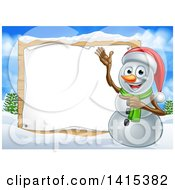Happy Snowman Wearing A Christmas Santa Hat And Pointing To A Blank Sign In A Winter Landscape