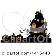 Clipart Of A Lit Haunted Halloween House With Bats And Jackolanterns Royalty Free Vector Illustration