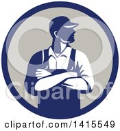 Clipart Of A Retro Male Farmer With Folded Arms Looking To The Side In A Blue And Gray Circle Royalty Free Vector Illustration