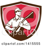 Clipart Of A Retro Male Carpet Cleaner In A Brown White And Pink Shield Royalty Free Vector Illustration