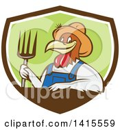 Clipart Of A Retro Cartoon Farmer Rooster Chicken Man Wearing Overalls And A Straw Hat Holding A Pitchfork In A Brown White And Green Shield Royalty Free Vector Illustration