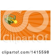 Clipart Of A Retro Fire Breathing Dragon Emerging From A Shield And Orange Rays Background Or Business Card Design Royalty Free Illustration by patrimonio