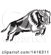 Clipart Of A Black And White Retro Woodcut Leaping And Running Buffalo Royalty Free Vector Illustration by patrimonio