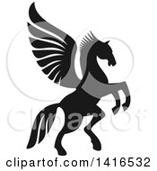 Clipart Of A Black And White Silhouetted Rampant Winged Horse Pegasus Royalty Free Vector Illustration