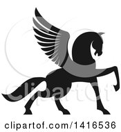 Clipart Of A Black And White Silhouetted Rampant Winged Horse Pegasus Royalty Free Vector Illustration by Seamartini Graphics