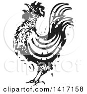 Clipart Of A Black And White Woodcut Rooster Crowing Royalty Free Vector Illustration