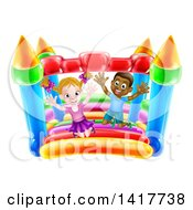 Clipart Of A Cartoon Happy White Girl And Black Boy Jumping On A Bouncy House Castle Royalty Free Vector Illustration by AtStockIllustration