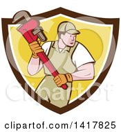 Clipart Of A Retro Cartoon White Male Plumber Or Handy Man Running With A Monkey Wrench In A Bown White And Yellow Shield Royalty Free Vector Illustration